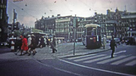 köln : COLOGNE, GERMANY - 1966: Morning commuter traffic fill the streets as the city awakes. . Unique vintage 8mm film home movie professionally cleaned and captured in 4k 3840x2160 UHD resolution plus post processing including cinematic retro color correction,