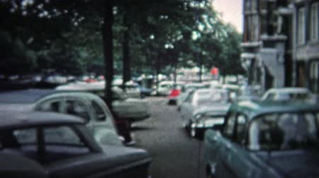 kodaň : COPENHAGEN - 1966: The city alive with people and a modern 1960s look.. Unique vintage 8mm film home movie professionally cleaned and captured in 4k 3840x2160 UHD resolution plus post processing including cinematic retro color correction, manual speed ad