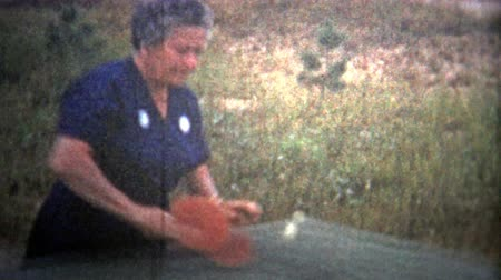 demokratický : ALBANY, NY. USA - 1953: Old woman practicing table tennis is steadily improving. Original vintage 8mm home movie film professionally cleaned and captured in 4k 3840x2160 UHD resolution plus post processing including cinematic retro color correction, defli Dostupné videozáznamy