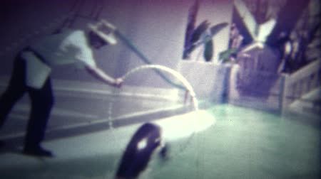abroncs : MIAMI, USA -1951: Seal jumping through a hoop at a popular hotel performance. Original vintage 8mm home movie film professionally cleaned and captured in 4k 3840x2160 UHD resolution plus post processing including cinematic retro color correction, deflicke Stock mozgókép
