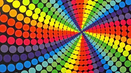 вихрь : Retro Rainbow Colored Dots Rotating Animation Background . Perfect seamless loop background and special effect psychoactive footage in full color of rotational design and pattern that create a spinning optical illusion vortex that can have mesmerising hyp Стоковые видеозаписи