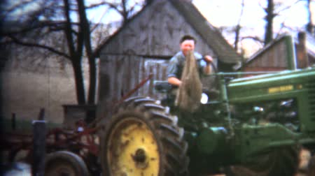 sinematografi : 8mm Vintage 1952 Proud Iowa Farmer on Tractor Stok Video