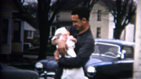 iowa : 8mm Vintage 1952 Dad Holds Baby Car  House Background. Iowa, USA.