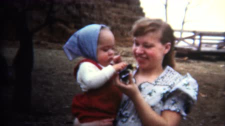 iowa : 8mm Vintage 1952 Iowa Mother Introducing Baby To Chicken Hatchling Stock Footage