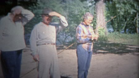 valóság : ARKANSAS, USA - 1965: Folks getting ready to go fishing with old cane poles.