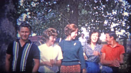 sinematografi : ARKANSAS, USA - 1965: Gang of nice teens showing the fashion trends of the time. Stok Video