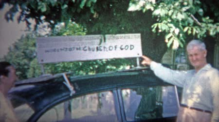 archívum : ARKANSAS, USA - 1966: A Church of God handmade sign is mounted on the parishioners car.