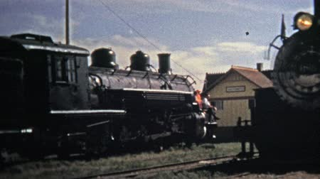 valóság : CUMBRES PASS, CO. - USA1972: Coal train cars Denver  Rio Grande take passengers across Colorado. Unique vintage 8mm film home movie professionally cleaned and captured in 4k 3840x2160 UHD resolution plus post processing including cinematic retro color cor