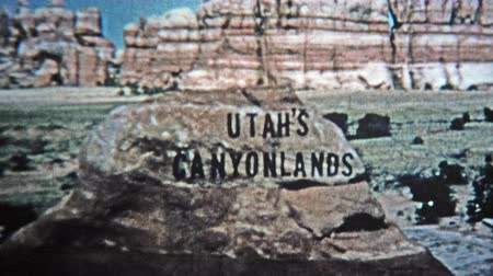 título : CANYONLANDS, UTAH -1971: Utah canyonlands old style analog title credit.  Unique vintage 8mm film home movie professionally cleaned and captured in 4k 3840x2160 UHD resolution plus post processing including cinematic retro color correction, manual speed a