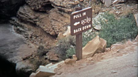 korszak : CANYONLANDS, UTAH -1971: Advanced Jeep offroad trails require special backing skills and control. Unique vintage 8mm film home movie professionally cleaned and captured in 4k 3840x2160 UHD resolution plus post processing including cinematic retro color co