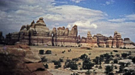 archívum : CANYONLANDS, UTAH -1971: Remote hiking proves rewarding with near-alien geological features. Unique vintage 8mm film home movie professionally cleaned and captured in 4k 3840x2160 UHD resolution plus post processing including cinematic retro color correct