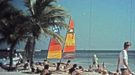 archívum : 1973: Catamaran sailboats color the beach landscape for tourism rentals.