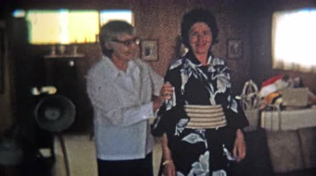 archívum : 1974: Women fitted for kimono in her home.