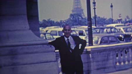 hrdý : 1969: Proud frenchman poses by his Eiffel Tower.