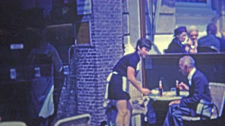 pokojowka : 1969: French maid bring out drinks at local restaurant bar.