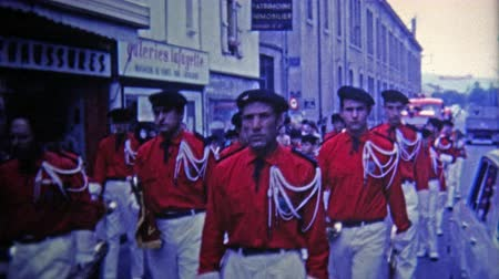 парад : 1969: French red marching band parade on main street.