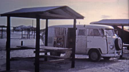 KEY WEST, FL -1971: Hippie VW van parked beach girls scenes.