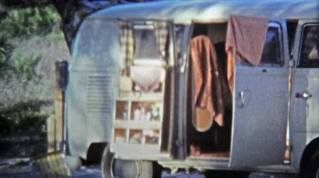KEY WEST, FL -1971: Hippie bus camping on beach with mailbox address.