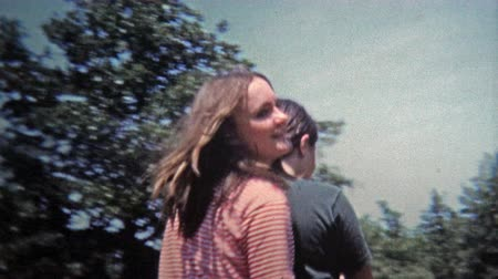 koń : GREENSBORO, NC -1971: Girls riding horse slow motion rideby. Wideo