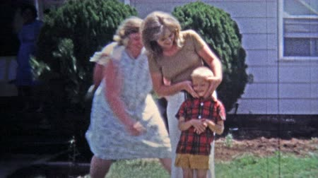 significar : GREENSBORO, NC -1971: Boy punches mother in face after she messes with son.