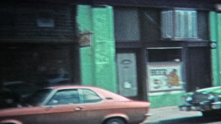 GREENSBORO, NC -1971: Main street of town with five cent beer at local bar.