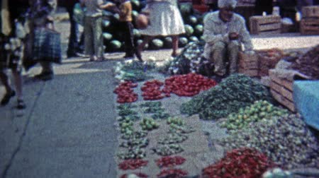 MEXICO CITY -1974: Outdoor food market selling peppers,tomatoes and melons.