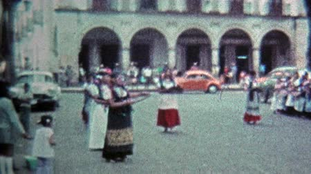 archívum : MEXICO CITY -1974: Traditional native dancing on city square for holiday event. Stock mozgókép