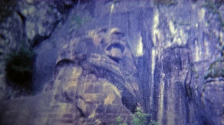 DUSSELDORF, GERMANY -1969: Lion carved into the side of the mountain.