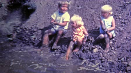 korszak : NEW ORLEANS, LA -1969: Kids playing in mud made from construction project.