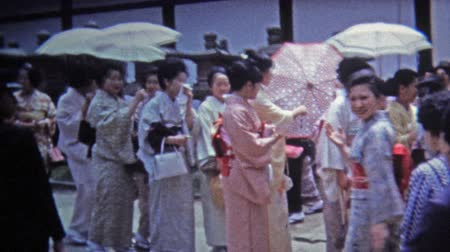 quimono : Okayama, JAPAN 1972: Women walking to a function in traditional Japanese kimono dress. Vídeos