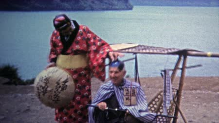 samuraj : Okayama, JAPAN 1972: Western tourists dressing up in ancient Japanese royalty fashion.