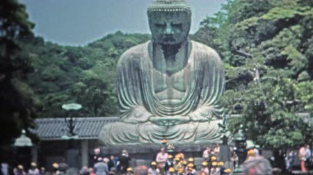 fazilet : SINGAPORE 1973: Wise Siddhartha Gautama Buddha statue in Asia tourist visits. Stok Video