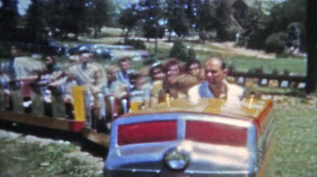 korszak : DENVER, COLORADO 1951: Family riding Elitch Gardens classic train ride Stock mozgókép