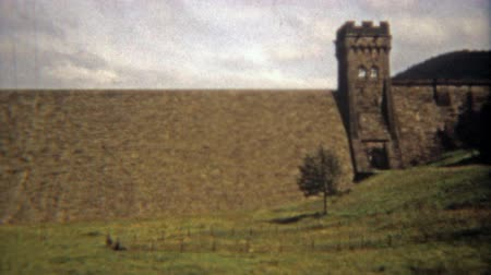 CORK, IRELAND 1973: Man walking top of medieval castle walls Wideo