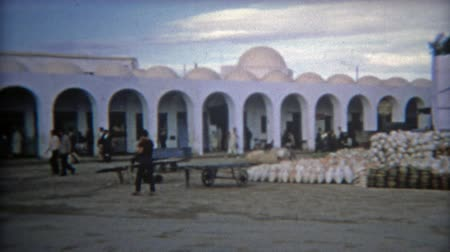 TUNIS, TUNISIA 1972: Tunisian marketplace hustle and bustle of Arab port city.