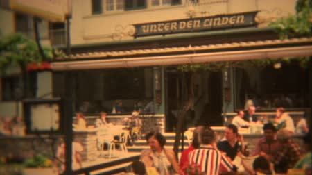 FRANKFURT, GERMANY 1973: German beer garden with people sitting outside in summer. Wideo