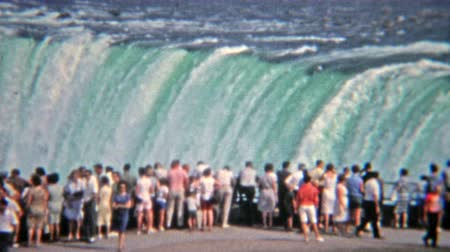 1965: Crowd observing flood water levels at Niagara Falls.