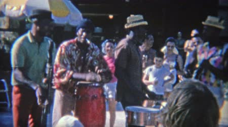 1956: Caribbean street band playing for tips from the tourists. MIAMI, FLORIDA
