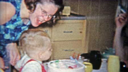 1962: Aunt smokes cigarette while kid blows out 2nd birthday cake candle. Wideo