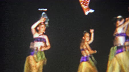 1957: Arabian style school performance by young girls costumed dance troupe.