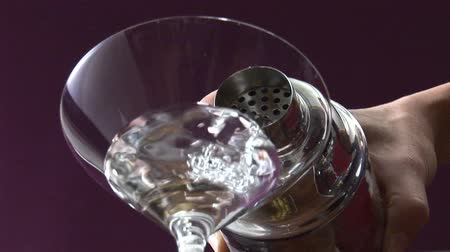 poured out : Pouring Martini from cocktail shaker into glass