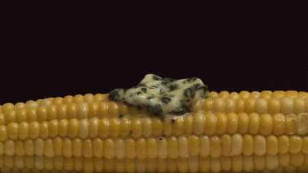 common salt : Cooked corn on the cob with melting herb butter and salt