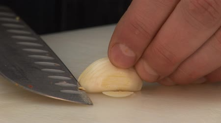 basic steps : Chopping a clove of garlic Stock Footage
