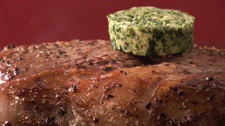 basic steps : Putting peppered steak with herb butter on an electric grill Stock Footage