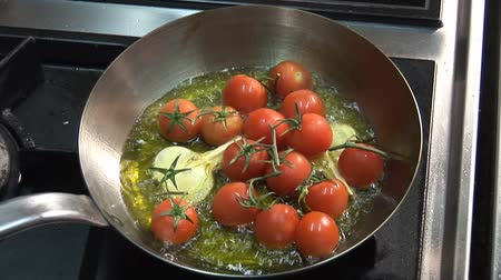 frypan : Frying tomatoes and garlic in oil Stock Footage
