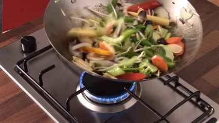 vegetable wok : Tossing vegetables and sprouts in a wok Stock Footage
