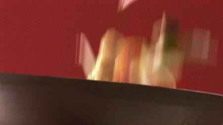 vegetable wok : Tossing vegetables in a wok Stock Footage