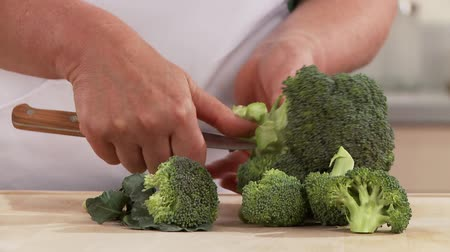 preparing : Broccoli being broken into florets Stock Footage