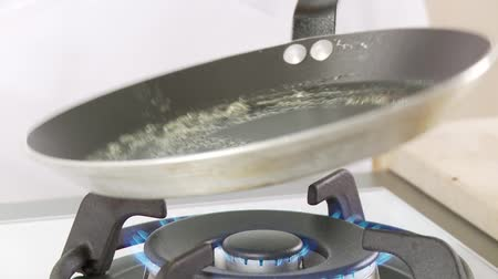 vaj : Butter being melted in a pan and pancake dough being poured in