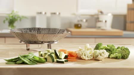 steaming basket : Prepared vegetables and a steamer